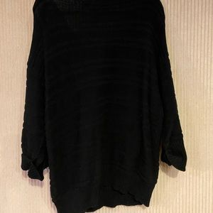 Three quarter sleeve length black sweater